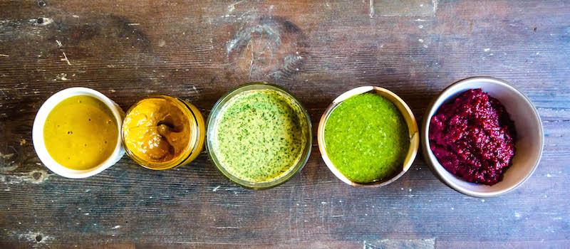 from left to right: Turmeric-Miso-Lime Sauce; Creamy Sun-dried Tomato-Goji Berry Sauce; Tangy Herbed Yogurt Dressing; Basil-Hemp Dressing; Beet Pesto